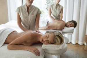 A man and woman receives massage treatments together