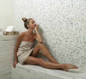 Image of a lady in spa robe in bath