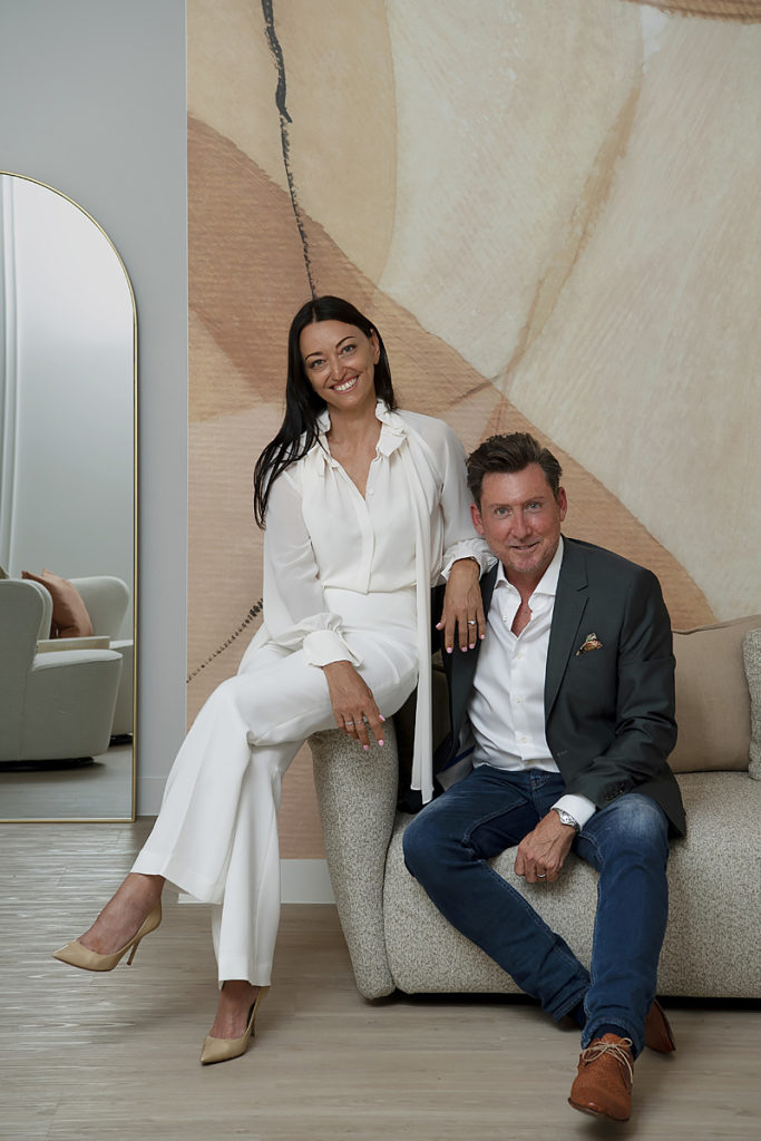 Tania and Danny (owners of BODHI) sit on chair in Cottesloe spa