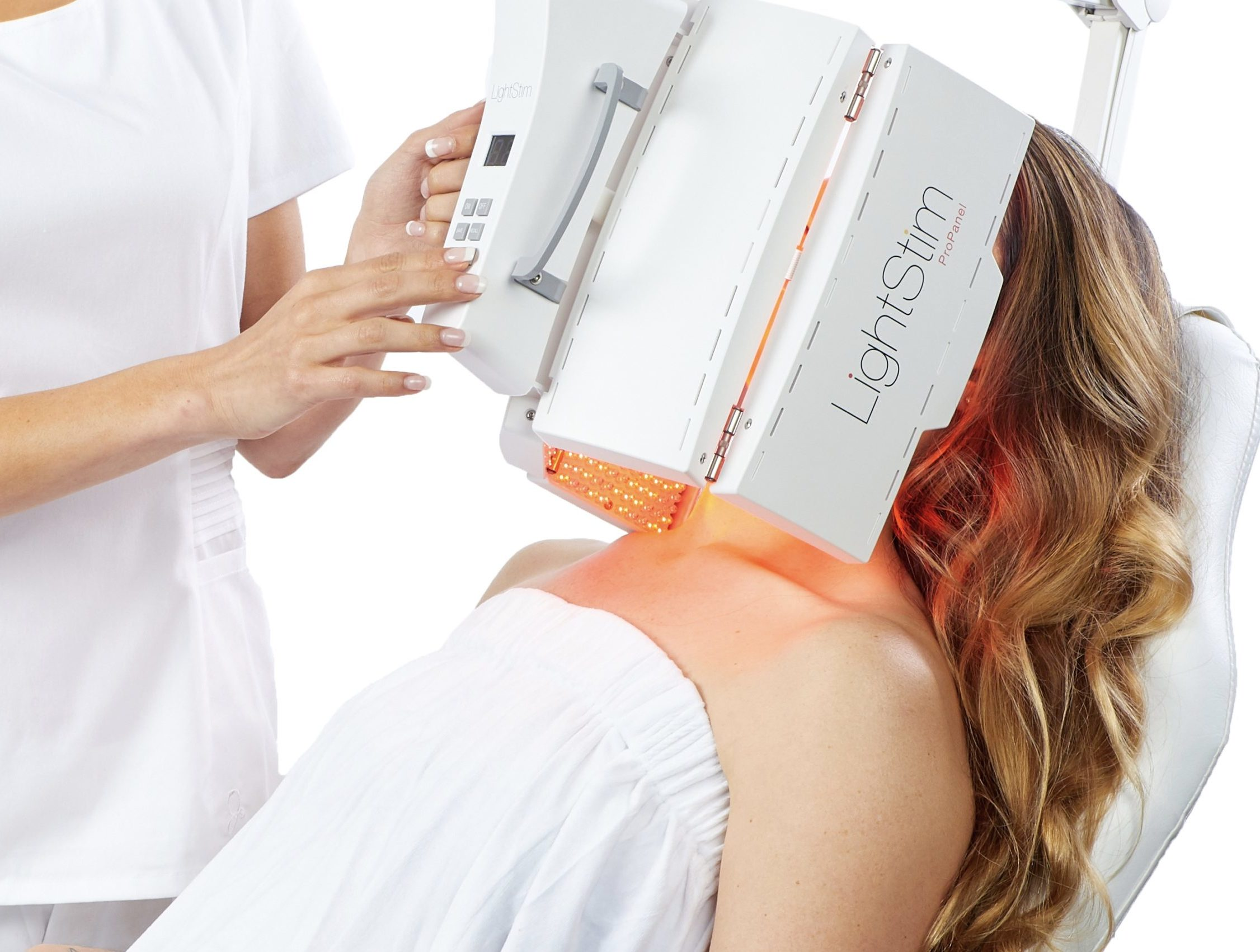Woman receives lightstim treatment to face